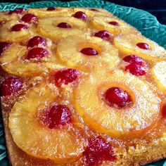 Pineapple Upside-Down Cake ~ incredibly light, moist cake with a thick caramelized crust encasing juicy pineapples and sweet cherries.