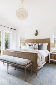 """The master bedroom is definitely the most tranquil room in the house. """"My client wanted a space she could unwind in, so we played up the light and kept the clutter to a minimum,"""" Barnes explained...."""
