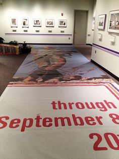 """With help from our facilities staff, the """"Searching for the Seventies"""" exhibit banners will go up on Constitution Ave."""