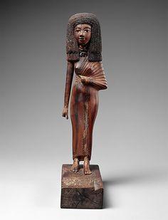 Statuette of the lady Tiye.  Period:     New Kingdom Dynasty:     Dynasty 18 Reign:     reign of Amenhotep III–Akhenaten Date:     ca. 1390–1349 B.C.  Medium:     Wood, carnelian, gold, glass, Egyptian blue, paint