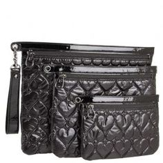 Betseyville Be Mine 4Ever 3 Peice Pouch- Black - To ensure stylish results, make sure to lock up your prized essentials in the lovely Betseyville Be Mine 4Ever 3 Piece Cosmetic Pouch. Three piece cosmetic case made of synthetic heart-quilted patent leather. Holds your cosmetics, brushes, and, toiletries. Single removable wrist strap.Secure top-zip closure. Print-lined interior.Betseyville bags are designed by Betsey Johnson and has been rocking the fashion industry with her unique and…