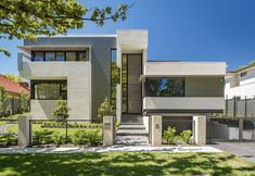 Yarra House II   DNA Architects #architecture #design #house #canberra #residential #modern #facade #frontdoor #streetview #concrete #cladding #windows