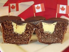 """Nanaimo Bar Cupcakes C & C Cakery: """"Yes, it may not seem like much - but the taste. You bite into one of these puppies, and you'll be singing O Canada! even if you don't know the words. Our special chocolate graham coconut cake was specially developed to remind you of that famous bar, while the vanilla custard filling and bittersweet chocolate ganache comes straight from the original recipe."""" {will have to make these for our Canada Day Celebration!!}"""