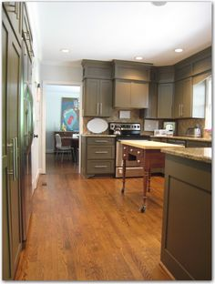 Kitchen minor remodel. She re-trimmed, re-doored and painted existing kitchen cabinets.
