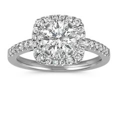 This striking halo engagement ring features 49 round pav