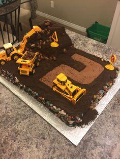 Digger Cake Dirt digger cake. Chocolate buttercream and chocolate cookie dirt. Chocolate rocks around the edging. Chocolate sponge boulders...