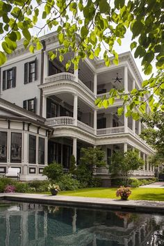 Love the tiered porches of this colonial home.