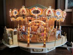 MINIATURE CAROUSEL BUILDER, ROBERT BIEHLER 87 year old Retired teacher creates a masterpiece. When Robert looked through books about carousels he decided the one he liked the most was the Dentzel Carousel at Kiddieland in Cedar Park. Ohio, and that became his guide.