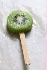 Then put the kiwi on a Popsicle stick
