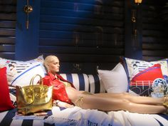 Even the Polo window displays are consistent with the lifestyle branding.  The mannequin is dressed in Polo, lounging on nautical themed pillows creating the illusion of being on a yacht or at the beach.
