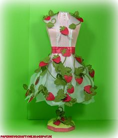 Wow!  Check out what Elke did to this beautiful Dress Form from DRESS SHOP SVG KIT!  After making the form, she made the skirt by using the petals of the Amaryllis from HOME FOR THE HOLIDAYS SVG KIT, cutting them out of transparent paper!  Then she decorated with the Strawberries and Branches from STRAWBERRY LANE SVG COLLECTION to complete this fabulous look!  Fashion-forward, don't you think!