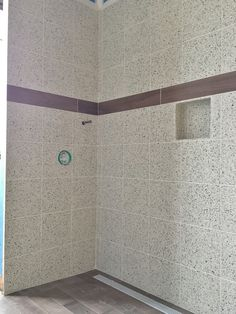 Smoothed Pebble Rock Shower Floor With A Linear Drain