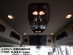 http://www.conversionsforsale.com/4316-2015-ford-transit-van-xl-9-passenger-explorer-conversion-van/details.html
