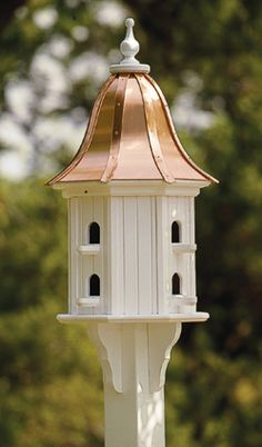 """American craftsmen make our handsome birdhouse of PVC board construction. It measures 36"""" from the base of the mount to the top of the finial. Mount on a 4"""" x 4"""" pressure treated post (sold at home improvement centers). A vinyl sleeve is available to cover the post."""