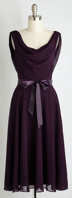 deep plum draped dress. I could do without the bow, but I love the cut and color