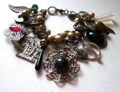 Vintage Black - Found Object  - Black Gothic - Assemblage  Charm Bracelet - BootsiesWorld. $58.99, via Etsy.