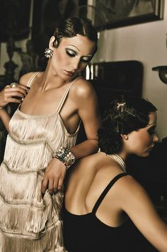 flappers.  At VargaStore.com we love the Roaring 20s Fashion.  Women's Dresses, tops, bottoms.......we love it all!