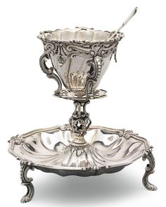 JOHANNES GERARDUS L'HERMINOTTE DUTCH SILVER SUGAR STAND,  shaped circular, on three cast supports, detachable silver liner; with six silver teaspoons, Thomas & William Chawner, London, circa 1765, the bowl backs struck with scrolls, the terminals initialled H / SM,  Maastricht, 1768-1770