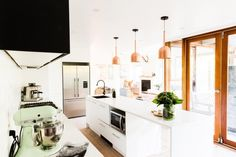 Black and whit kitchen l Copper pendant lights l Scandinavian kitchen l Reno Rumble Week 2 Full House Reveal l Photos of All Rooms