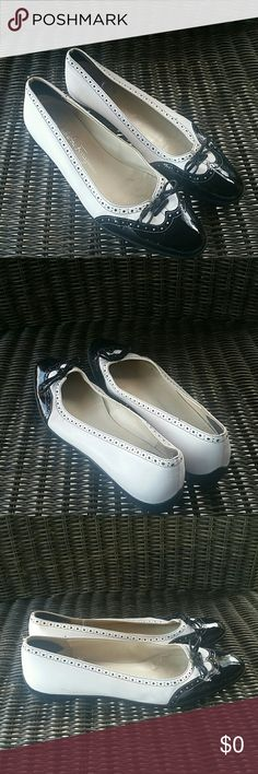 7.5 A Salvatore Ferragamo Boutique B&W Flats Leather in great condition. Minor creasing. Wear noticeable on the footbed and inner walls.  Soles are great. Salvatore Ferragamo Shoes Flats & Loafers