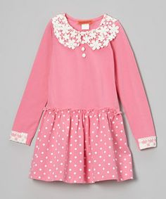 Flaunting all the fun of being young, this dress stars a flower-strewn collar crafted from dainty lace. A peppy polka dot skirt rounds out the look with its charmingly gathered waist—and best of all, this frock's soft, stretchy cotton blend keeps little ladies comfy all day.