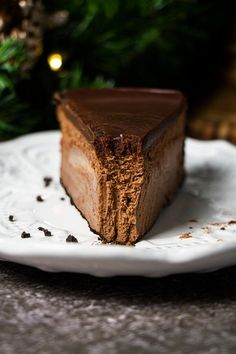 Cheesecake is one of my favorite desserts, and this Triple Chocolate Cheesecake with Oreo Crust is probably my favorite type. There is nothing more velvety, rich, and decadent than this cheesecake. #cheesecakerecipe #bakingcheesecakerecipe #chocolatecheesecakerecipebest #cakecheesecake #perfectcheesecakerecipe #cheesecakerecipeschocolate #cheesecakerecipeholiday #chocolaterecipees #chocolatecakerecipes #creamycheesecakerecipe #chocollatecheesecake #howtomakecheesecake Fun Baking Recipes, Sweet Recipes, Dessert Recipes, Yummy Recipes, Oreo Crust Cheesecake, Homemade Cheesecake, Triple Chocolate Cheesecake, Chocolate Cakes, Chocolate Recipes