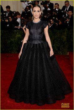 Maggie Q is glamorous as can be in a black dress while walking the red carpet at the 2014 Met Gala held at the Metropolitan Museum of Art