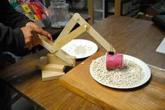 In this activity, learners build their own construction cranes using tongue depressors and pushpins. Learners use simple tools to build the cranes and then have fun operating the crane to scoop and drop different materials like cereal, beans, or sand. Use this project to introduce learners to simple machines, specifically levers.