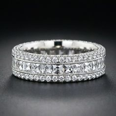 A gorgeous, newly handcrafted, 6 millimeter wide platinum and diamond band ring sparkling with a central finely milgrained channel of bright-white, high-quality French-cut diamonds. The French-cuts are bordered by precision-set round brilliant-cut diamond Diamond Bands, Diamond Jewelry, Diamond Cuts, Wide Diamond Wedding Bands, Gold Jewellery, Jewellery Shops, Jewellery Holder, Platinum Wedding Rings, Designer Jewellery