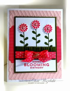 handmade card found on Me, My Stamps and I blog ... red, white and pink with black accents ... great design ... punched and popped up flower heads on stamped leafy stems ... delightful polka dow bow ... Stampin' Up!