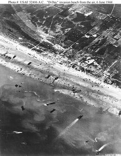 "Normandy Invasion, June 1944: ""D-Day"" beach traffic, photographed from a Ninth Air Force bomber on 6 June 1944. Note vehicle lanes leading away from the landing areas, and landing craft left aground by the tide."
