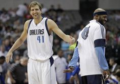 Dallas Mavericks forward Dirk Nowitzki (41) shares a laugh with Memphis Grizzlies guard Vince Carter (15) before the start of a preseason game at American Airlines Center in Dallas on Monday, October 20, 2014. (Vernon Bryant/The Dallas Morning News)