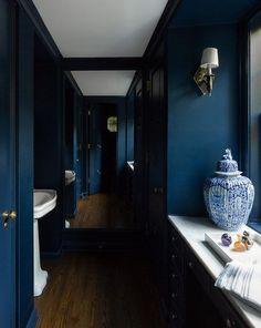 Deep blue powder room walls