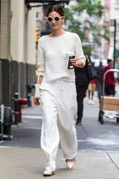 Make a statement like Lily Aldridge by covering up in head-to-toe white. A slouchy knit and baggy pants, accessorized to perfection, is a failsafe formula.