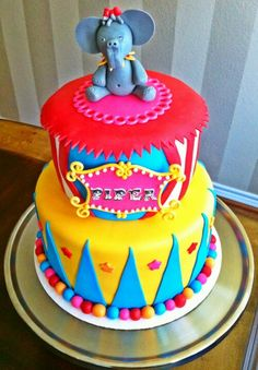 """Bright pink added to the primary colors...I like the fondant ball border at the bottom. We could do a """"circusy"""" name plate. @flturn3 Follow the board: Circus/Carnival Cake ideas"""