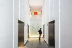 Nulty - City Tower, City of London - Sophisticated Bright Commercial Lift Lobby Clean Vertical Lines Cool Lighting Design