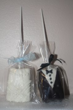 Bride & Groom chocolate covered Rice Krispie treat lollipops for a bridal shower or wedding favor. They turned out so cute!!