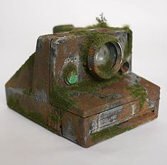 """""""Modern Gadgets Turned Into Relics"""" - a unique photo series by Japanese artist Maico Akiba.     From bitrebels:  http://www.bitrebels.com/technology/modern-gadgets-aged-100-years/"""