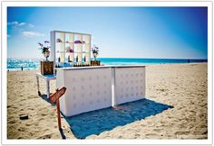 A bar on the sand for a San Diego beach wedding.  Design by Alchemy Fine Events, Florals by Isari Flower Studio