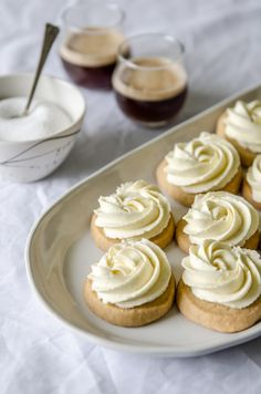 Frosted Vanilla Sugar Cookies | Queen Fine Foods | Topped with the creamiest of vanilla frosting, these tender cookies melt on the tongue and are a vanilla lovers dream.