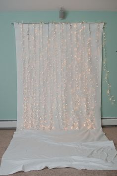 This would be cute as an accent wall at a wedding. Not the dragging curtain on the bottoms but deffinitely the lights.