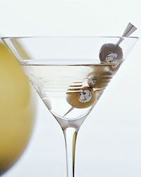 James Bond Martini  Ice  3 ounces gin  1 ounce vodka  1/2 ounce Lillet Blanc  3 blue cheese-stuffed olives, skewered on a pick  Fill a cocktail shaker with ice. Add the gin, vodka and Lillet Blanc. Shake well and strain into a chilled martini glass. Garnish with the stuffed olives.