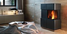 The Chiara wood pellet stove stands out with its wide view of the flames and narrow design. This is achieved by the stove's angular glass and steel panels. Pellet Fireplace, Wood Pellet Stoves, Convection Stove, Fire Pots, Wood Pellets, Steel Panels, Decoration, Cast Iron, Furniture