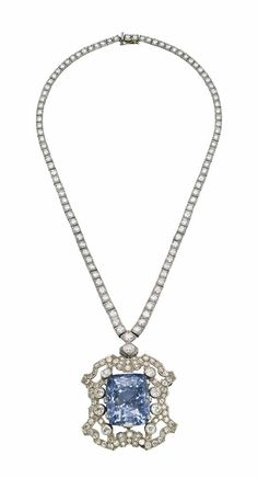 A SAPPHIRE AND DIAMOND NECKLACE/BROOCH -  The detachable pendant/brooch centering upon a cushion-shaped sapphire, weighing approximately 86.03 carats, in an openwork diamond set surround, to an associated diamond-line neckchain, 1930s by shawna