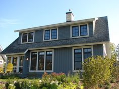 Painted cedar shingles. Would like to do this to a lake house, paint it a smoky blue or gray color, then leave the trim cream and replace windows w/ dark window grilles