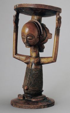 """Democratic Republic of the Congo;Luba peoples Chief's stool Wood H. 50.8 cm  The predominately female imagery adorning the emblems of male kings and officeholders in Luba society reflects the ambiguity and two-sided nature of power. As one Luba proverb has it, """"Men are chiefs in the daytime, but women are chiefs at night.""""..."""