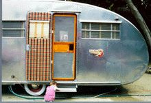 Camper door. How cute is this? Our doors (exterior and screen) are in bad shape. This gives me ideas!