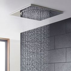 Love this ceiling tile spa effect shower head by Hudson Reed.