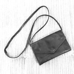 "Vintage J. Duseu Leather Crossbody Purse/Clutch Vintage leather handbag by J. Duseu in black supple buttery leather. Envelope style with snap closure and large rear zipper pocket (would fit phone, keys, lipstick, etc. interior has 2 large pockets (bottom) that would also hold cash or your phone, etc., a pen holder, 9 card slots, and a zippered pouch for small items (it is the size of the gold over flap). Strap detaches for wallet or clutch style. Measures 9"" x 5.5"" and rear pocket is 1""…"