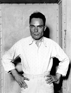 Assassin Giuseppe Zangara, an Italian immigrant with a ferocious hatred for politicians, strikes a defiant pose in a Miami jail. He was executed two weeks after the death of Chicago Mayor Anton Cermak, who he killed intending to shoot Franklin Roosevelt. (Photo courtesy UPI/Corbis- Bettmann)